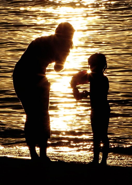Långholmen beach sunset July 2010 child mother water sun light warm summer